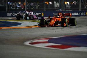 Sebastian Vettel, Ferrari SF90, leads Sergio Perez, Racing Point RP19