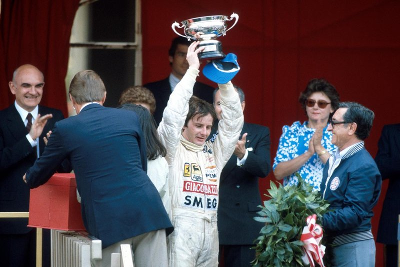 Gilles Villeneuve, Ferrari raises his trophy on the podium