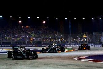 Lewis Hamilton, Mercedes AMG F1 W10, leads Valtteri Bottas, Mercedes AMG W10, and Alexander Albon, Red Bull Racing RB15