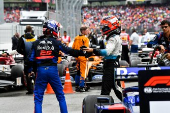 Robert Kubica, Williams Racing, congratulates Daniil Kvyat, Toro Rosso, 3rd position, in Parc Ferme