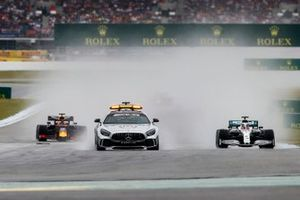 The Safety Car leads the field at the start of the formation lap