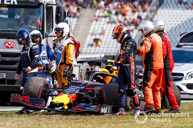Marshals and doctors assist Pierre Gasly, Red Bull Racing RB15, after a crash