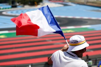 A fan waves the French flag