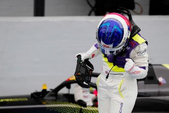 Jamie Chadwick celebrates in Parc Ferme after winning the race