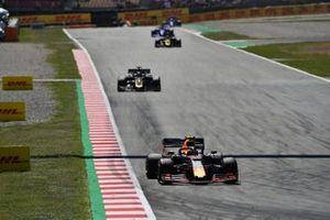 Pierre Gasly, Red Bull Racing RB15, leads Romain Grosjean, Haas F1 Team VF-19