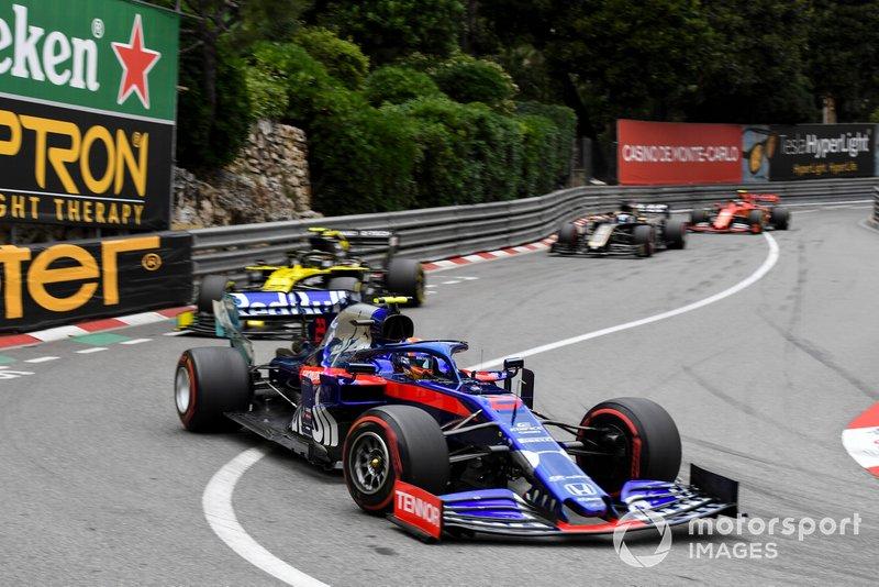 Alexander Albon, Toro Rosso STR14, leads Nico Hulkenberg, Renault R.S. 19, and Romain Grosjean, Haas F1 Team VF-19