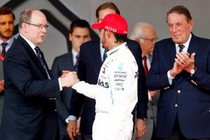 Lewis Hamilton, Mercedes AMG F1, 1st position, is greeted on the podium by Prince Albert II of Monaco
