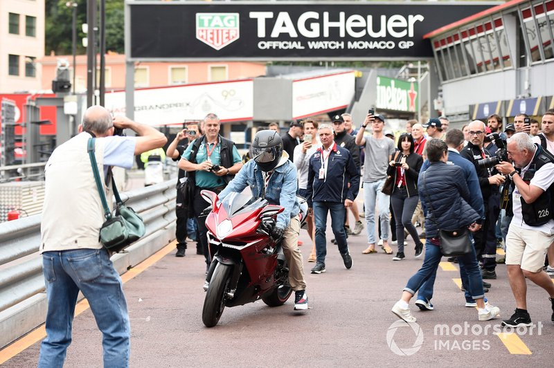 Lewis Hamilton, Mercedes AMG F1 on his motorbike in the pit lane