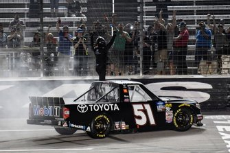 Greg Biffle, Kyle Busch Motorsports, Toyota Tundra Toyota, does a burnout after winning