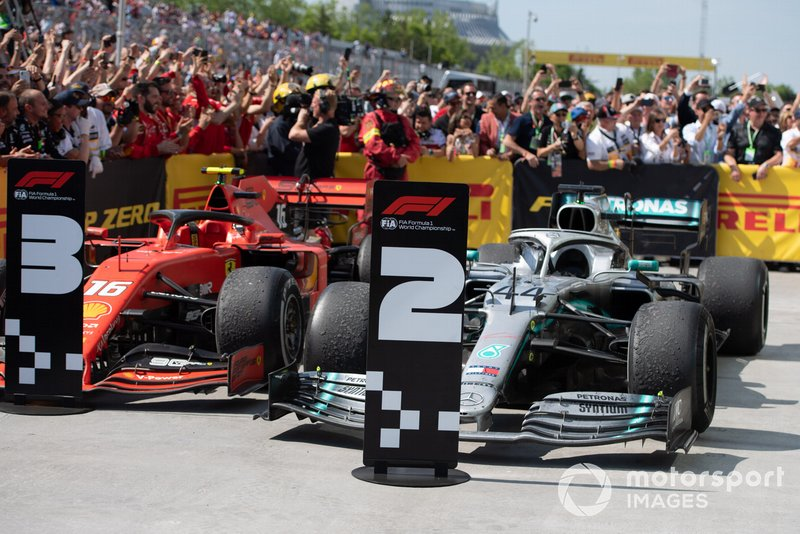 The cars of Charles Leclerc, Ferrari SF90, 3rd position, and Lewis Hamilton, Mercedes AMG F1 W10, 1st position, in Parc Ferme, with position boards corrected by Sebastian Vettel, Ferrari, 2nd position