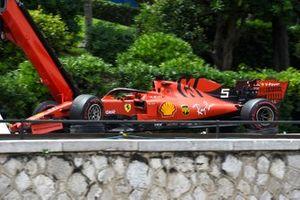 The car of Sebastian Vettel, Ferrari SF90, on a truck after a crash in practice