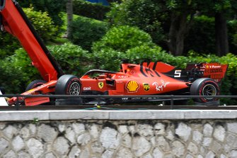 The car of Sebastian Vettel, Ferrari SF90, on a truck after a crash in practice