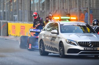 Daniil Kvyat, Toro Rosso STR14, climbs out of his car after a crash during FP2