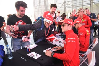 Sebastian Vettel, Ferrari and Charles Leclerc, Ferrari sign autographs for fans