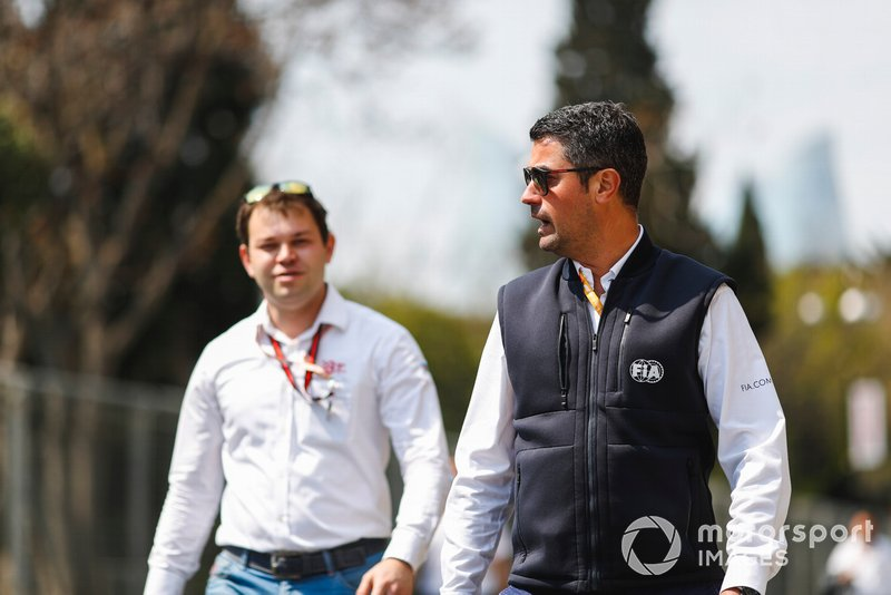 FIA Officials walking the track