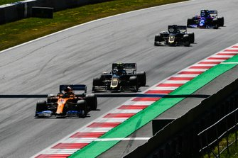 Carlos Sainz Jr., McLaren MCL34, leads Kevin Magnussen, Haas F1 Team VF-19, Romain Grosjean, Haas F1 Team VF-19, and Alexander Albon, Toro Rosso STR14