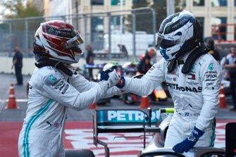 Lewis Hamilton, Mercedes AMG F1, 2nd position, congratulates Valtteri Bottas, Mercedes AMG F1, 1st position, in Parc Ferme