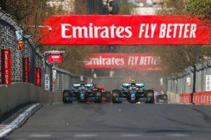 Valtteri Bottas, Mercedes AMG W10 and Lewis Hamilton, Mercedes AMG F1 W10 battle on lap1