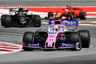 Sergio Perez, Racing Point RP19, leads Kevin Magnussen, Haas F1 Team VF-19, and Sebastian Vettel, Ferrari SF90