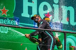 Lewis Hamilton, Mercedes-AMG F1, 1st position, and Valtteri Bottas, Mercedes-AMG F1, 2nd position, spray Champagne on the podium