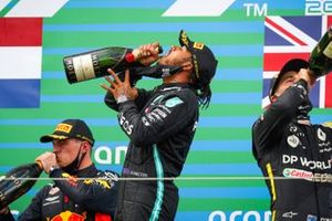 Daniel Ricciardo, Renault F1, 3rd position, Lewis Hamilton, Mercedes-AMG F1, 1st position, and Max Verstappen, Red Bull Racing, 2nd position, celebrate on the podium with Champagne