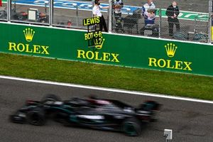 Lewis Hamilton, Mercedes F1 W11, passes his pit board