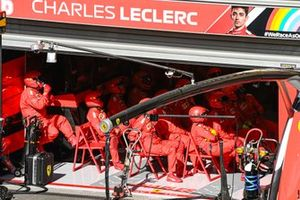 The Ferrari pit crew at rest in the garage