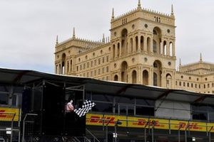 The chequered flag is waved for the F2 race finish