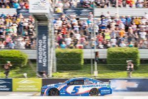 Kyle Larson, Hendrick Motorsports, Chevrolet Camaro crossing the finish line after tire failure