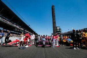 Helio Castroneves, Meyer Shank Racing Honda, Marcus Ericsson, Chip Ganassi Racing Honda, and Ryan Hunter-Reay, Andretti Autosport Honda on the grid
