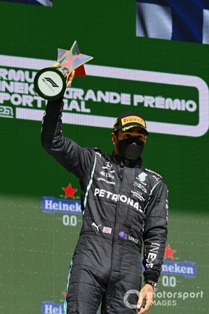 Lewis Hamilton, Mercedes, 1st position, with his trophy