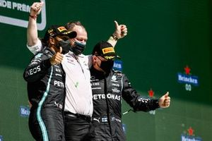 Lewis Hamilton, Mercedes, 1st position, and Valtteri Bottas, Mercedes, 3rd position, celebrate on the podium with their team mate