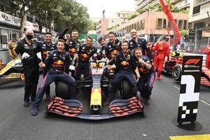 The Red Bull team celebrate in Parc Ferme