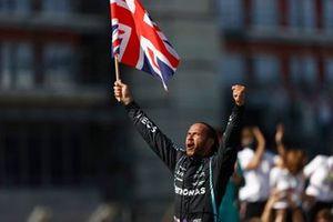 Lewis Hamilton, Mercedes, 1st position, celebrates after the race with a Union flag