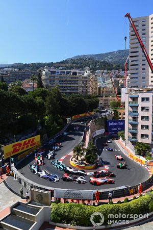 The cars make their way round the hairpin on the opening lap