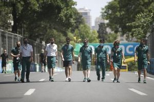 Lance Stroll, Aston Martin AMR21 and team members track walk