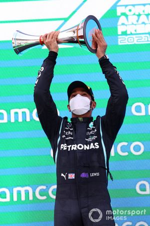 Lewis Hamilton, Mercedes, 1st position, lifts his trophy