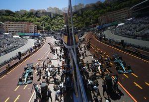 Daniel Ricciardo, McLaren MCL35M, in the pits as Sebastian Vettel, Aston Martin AMR21, passes