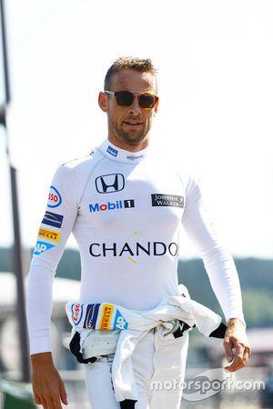 Jenson Button, McLaren walks in the paddock.