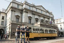 Daniel Ricciardo, Carlos Sainz Jr. and Daniil Kvyat pose for a portrait in front of La Scala theater