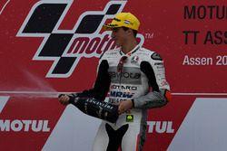 Podium: winner Francesco Bagnaia, Aspar Team Mahindra celebrates with champagne