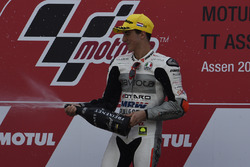 Podium: winner Francesco Bagnaia, Aspar Team Mahindra celebrates with champagne
