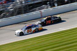 Reed Sorenson, Premium Motorsports Chevrolet, Martin Truex Jr., Furniture Row Racing Toyota