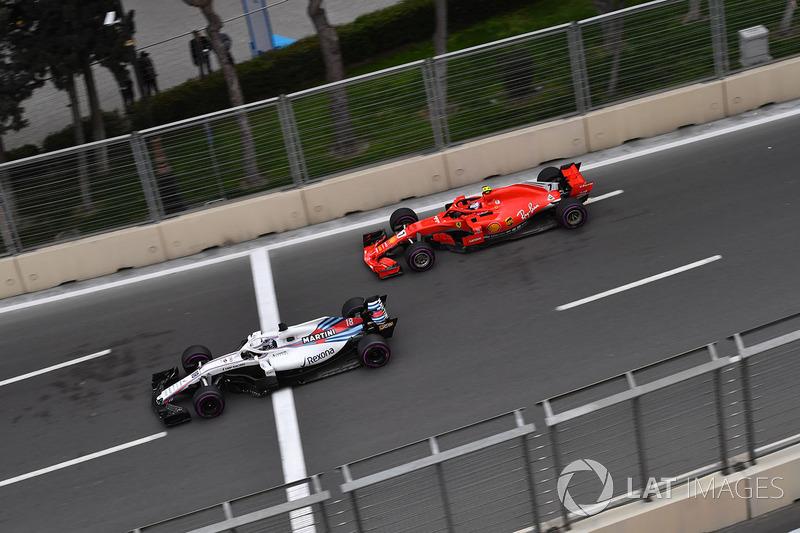 Lance Stroll, Williams FW41 et Kimi Raikkonen, Ferrari SF71H
