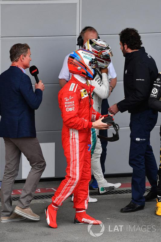 Kimi Raikkonen, Ferrari and Lewis Hamilton, Mercedes-AMG F1 in parc ferme
