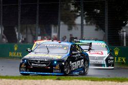 Nick Percat, Brad Jones Racing Holden, leads Michael Caruso, Nissan Motorsport Nissan