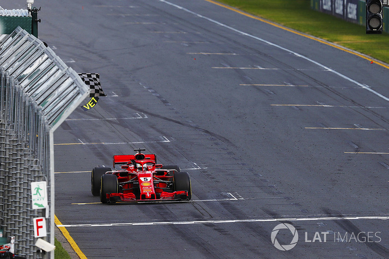 Sebastian Vettel, Ferrari SF71H, takes the chequered flag ahead of Lewis Hamilton, Mercedes AMG F1 W09