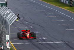 Sebastian Vettel, Ferrari SF71H, takes the chequered flag ahead of Lewis Hamilton, Mercedes AMG F1 W09