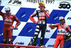 Podium: Race winner Valentino Rossi, second place Garry McCoy, third place Jorge Martinez