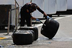 Red Bull Racing mechanic washes Pirelli tyres